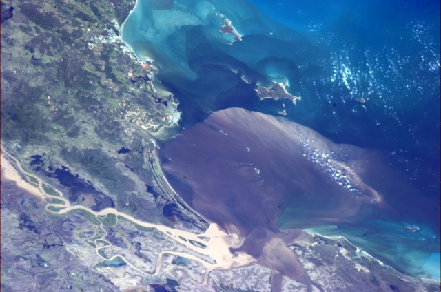 """Floodwaters pour into the Coral Sea near Rockhampton, Australia on Tuesday morning."" - Chris Hadfield"
