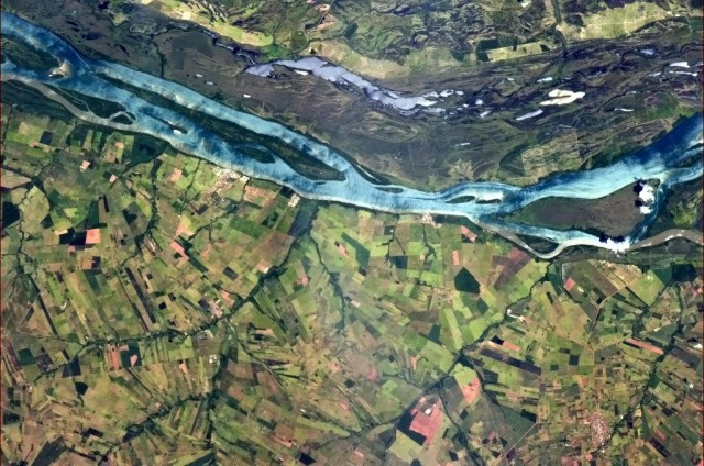 """A blue river in Brazilian farmland provides a striking contrast of colour and landscape."" - Chris Hadfield"