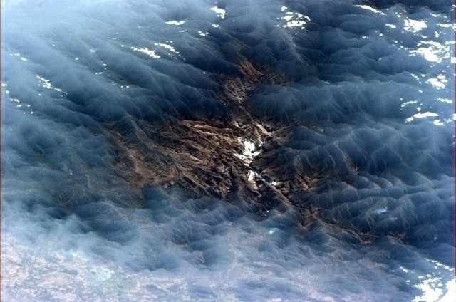 """Venezuelan valley framed by misty clouds - mysterious, beautiful and surreal."" - Chris Hadfield"