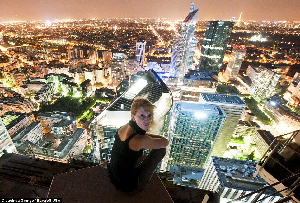 Top of the world: Ms Grange on top the Carpe Diem building at night in the central business district of Paris