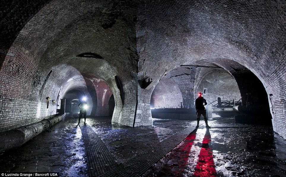 Deep and dark: Ms Grange's photos of tunnels below the street of London when her and her friend ventured below the capital in search of the underground River Fleet