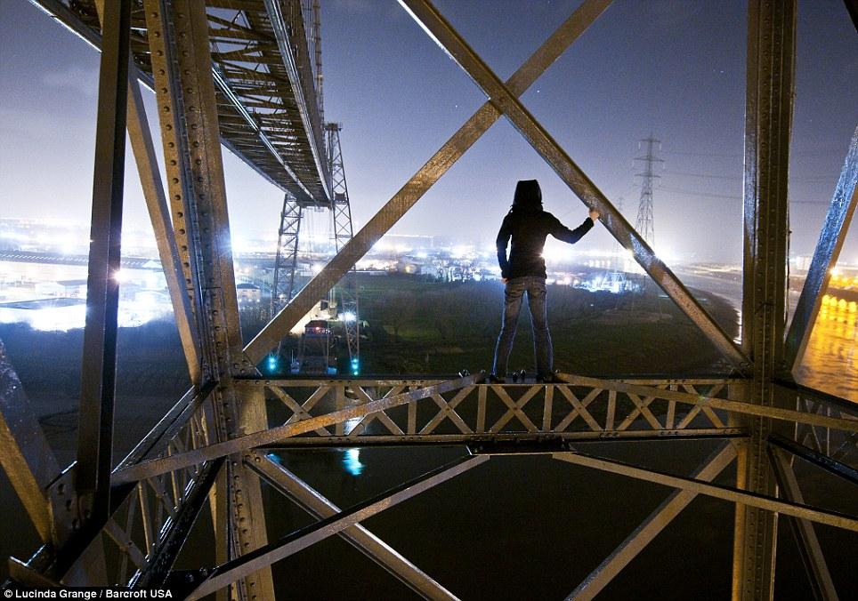 Exploring every corner of the globe: Ms Grange stood on the Transporter Bridge in Newport, Wales